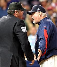 Twins manager Ron Gardenhire argues with umpire Hunter Wendelstedt. (Brace Hemmelgarn-US Presswire)