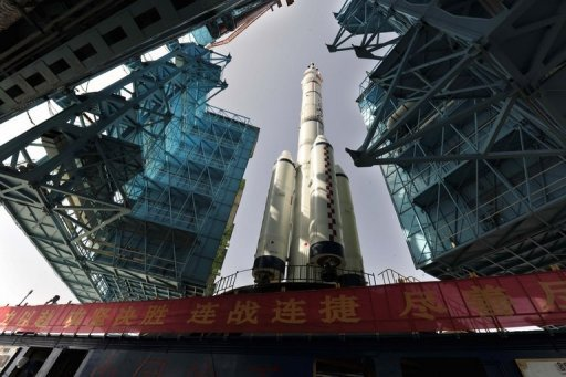 "The Shenzhou-10 on its launch pad in Jiuquan, in the Gobi desert, on June 3, 2013. The Shenzhou-10 -- the name means ""Divine Vessel"" -- was due to lift off at 0938 GMT"