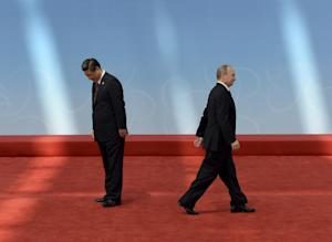 Vladimir Putin leaves after being greeted by  Xi J…