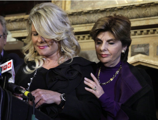 "Sharon Bialek, left, a Chicago-area woman, prepares to addresses a news conference at the Friars Club, with her attorney Gloria Allred, in New York,  Monday, Nov. 7, 2011. Bialek accused Republican presidential contender Herman Cain of making an unwanted sexual advance against her more than a decade ago, saying she wanted to provide ""a face and a voice"" to support other accusers who have so far remained anonymous. (AP Photo/Richard Drew)"