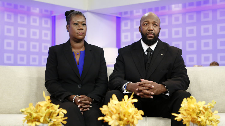 "In this image released by NBC, parents of Trayvon Martin, Sybrina Fulton, left, and Tracy Martin appear on the ""Today"" show in New York. Martin's parents plan to participate in separate vigils Saturday. Sabrina Fulton and her other son Jahvaris Fulton, will join Al Sharpton outside New York Police Department headquarters while Tracy Martin is set to be at a similar event at a federal courthouse in Miami. (AP Photo/NBC, Peter Kramer)"