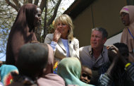 In this photograph taken during an official White House organized visit, Jill Biden, wife of U.S. Vice President Joe Biden, center, sits with Somali refugees during a photo opportunity at a UNHCR screening center on the outskirts of Ifo camp outside Dadaab, eastern Kenya, 100 kms (60 miles) from the Somali border, Monday Aug. 8, 2011. Jill Biden on Monday is visiting the world's largest refugee camp, Dadaab, where tens of thousands of Somali famine refugees have arrived in recent weeks. The U.S. says that more than 29,000 Somali children under the age of 5 have died from the famine in the last three months. (AP Photo/Jerome Delay)