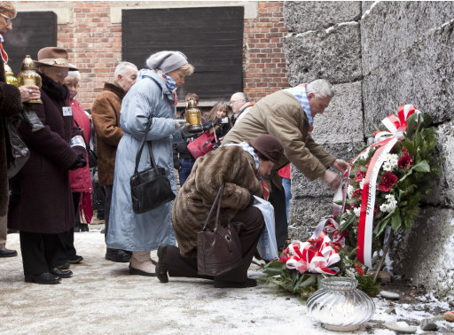 "Holocaust survivors lay wreaths at the ""Wall of Death"" at Auschwitz on the 67th anniversary of the death camp's liberation, in Oswiecim, Poland, on Friday Jan. 27, 2012. The Wall of Death was a site where Nazi Germans executed their victims at the notorious camp in occupied southern Polandthere. Survivors and others gather every year to commemorate those who perished on the anniversary of the camp's liberation by the Soviet Red Army on Jan. 27, 1945. (AP Photo/Katarzyna Guratowska)    POLAND OUT"