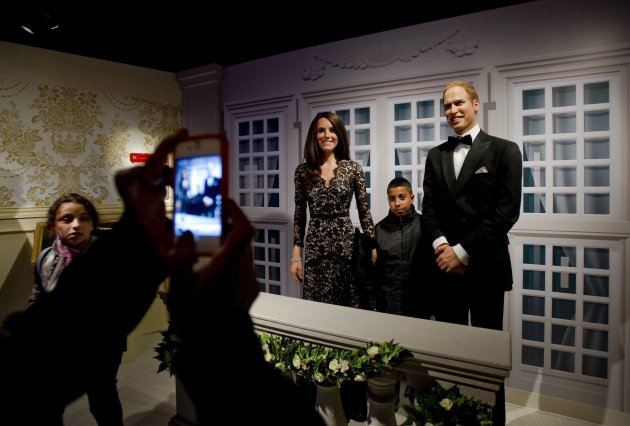 Visitors pose with wax models of Britain's William and Catherine, Duke and Duchess of Cambridge, at Madame Tussauds in Amsterdam