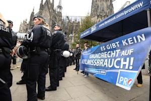 Police secure the area as sympathizers of German right …