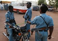 Sudanese police officers stand guard in Khartoum, 2010. University students staged anti-regime protests in Khartoum for the fifth straight day, with Sudanese riot police using tear gas and batons to disperse them (AFP Photo/Patrick Baz)