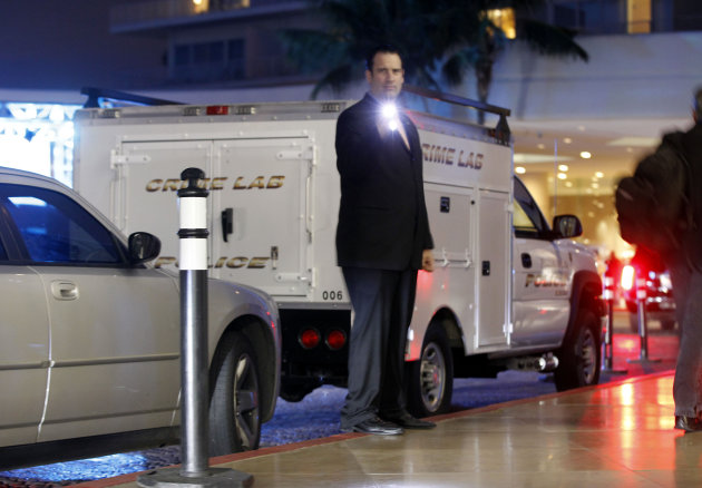 A Beverly Hills Police Crime Lab vehicle is seen outside the Beverly Hilton Hotel where singer Whitney Houston was found dead in Beverly Hills