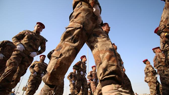 Fighters from the Abbas battalion of the Shiite Popular Mobilisation units march during a military parade in the southern Iraqi city of Basra on September 26, 2015