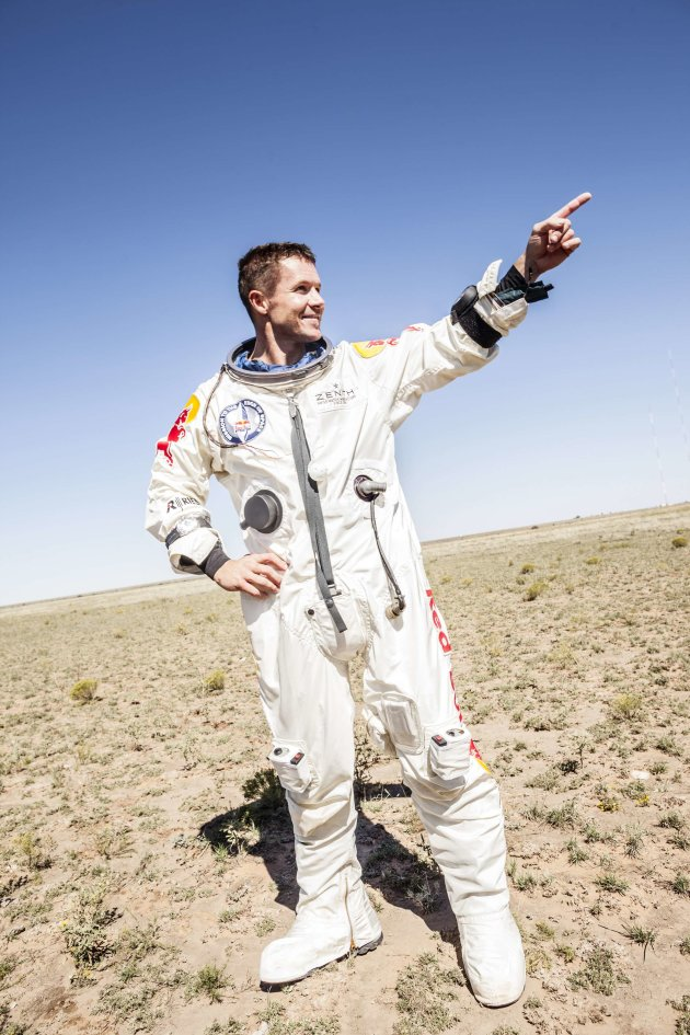 Handout of pilot Felix Baumgartner of Austria celebrating after successfully completing the final manned flight for Red Bull Stratos in Roswell