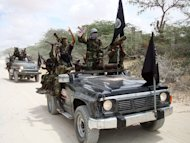 Militants belonging to Somalia?s Al-Qaeda-inspired Shebab Islamists ride vehicles and display weapons and flags in 2010. The US Central Intelligence Agency is using a secret facility in Somalia for counterterrorism purposes as well as a secret prison in the Somali capital, the magazine The Nation reported Tuesday