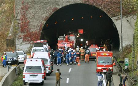 Police officers and firefighters gather in front of the Sasago Tunnel on the Chuo Expressway in Otsuki, Yamanashi prefecture, in this photo taken by Kyodo December 2, 2012. REUTERS/Kyodo
