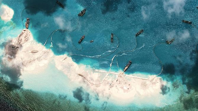 A satellite image of vessels purportedly dredging sand at Mischief Reef in the Spratly Islands in the disputed South China Sea taken by DigitalGlobe for the Asia Maritime Transparency Initiative on March 17, 2015
