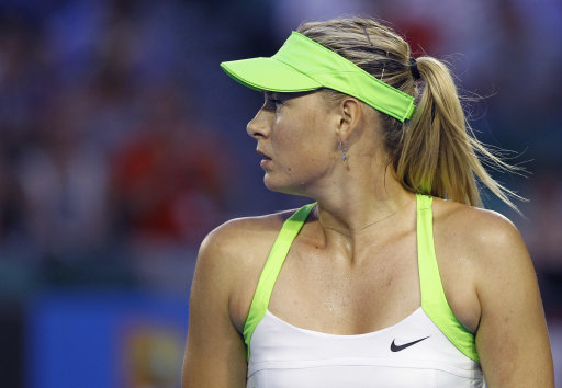 Maria Sharapova of Russia reacts as she plays Sabine Lisicki of Germany during their fourth round match at the Australian Open tennis championship, in Melbourne, Australia, Monday, Jan. 23, 2012. (AP Photo/Aaron Favila)
