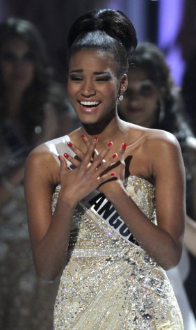 ALTERNATIVE CROP OF XAP114 - Miss Angola Leila Lopes reacts after being named Miss Universe 2011, before being crowned at the Miss Universe pageant in Sao Paulo, Brazil, Monday Sept. 12, 2011. (AP Photo/Andre Penner)