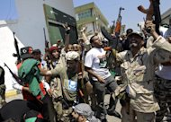 Rebels in Tripoli, whose call for Muammar Gaddafi to leave Libya has been backed by Foreign Affairs Minister Eamon Gilmore (AP)