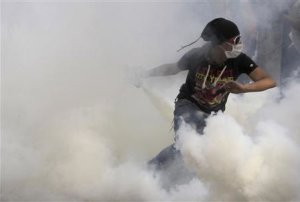 File photo of an an anti-Mursi protester running to …