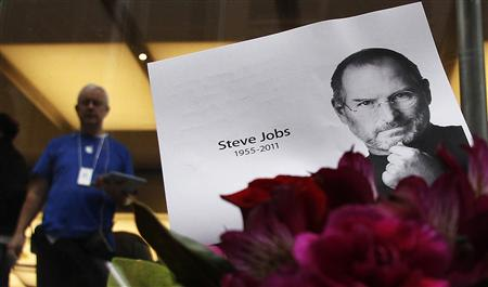Flowers in memory of Apple co-founder Steve Jobs are seen outside an Apple Store in Central Sydney