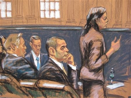 """Federal Defender Julia Gatto (R) speaks to the court as former New York City police officer Gilberto Valle (C), dubbed by local media as the """"Cannibal Cop"""", listens in this courtroom sketch on the first day of his trial in New York February 25, 2013. REUTERS/Jane Rosenburg"""