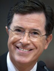 """FILE- This Thursday, June 30, 2011 file photo shows comedian Stephen Colbert as he appears before the Federal Election Commission in Washington. Comedy Central's """"Colbert Report"""" is currently off the air. An expected live version of the show was replaced by a repeat on Wednesday. Comedy Central said Thursday's live show will be off, too. The network said it was airing the repeats """"due to unforeseen circumstances,"""" but offered no other explanation. (AP Photo/Cliff Owen, File)"""