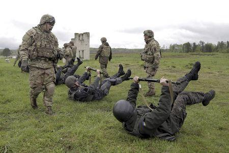 File picture shows servicemen of the U.S. Army's 173rd Airborne Brigade Combat Team training members of the Ukrainian National Guard during a...