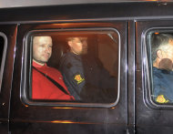 FILE - In this Monday July 25, 2011 file photo, Norway's twin terror attacks suspect Anders Behring Breivik, left, sits in an armored police vehicle after leaving the courthouse following a hearing in Oslo where he pleaded not guilty to one of the deadliest modern mass killings in peacetime. There's a long thread of delusion winding throughout the 1,518-page manifesto Breivik e-mailed to hundreds of people hours before he set out on his murderous rampage in Norway's capital and a nearby vacation island just over a week ago. But those who know Breivik told The Associated Press Saturday, July 30, 2011, that much is true about the manifesto's autobiographical material, which is interlaced with long political screeds and detailed instructions on bomb-making. (AP Photo/Aftenposten/Jon-Are Berg-Jacobsen, file) NORWAY OUT