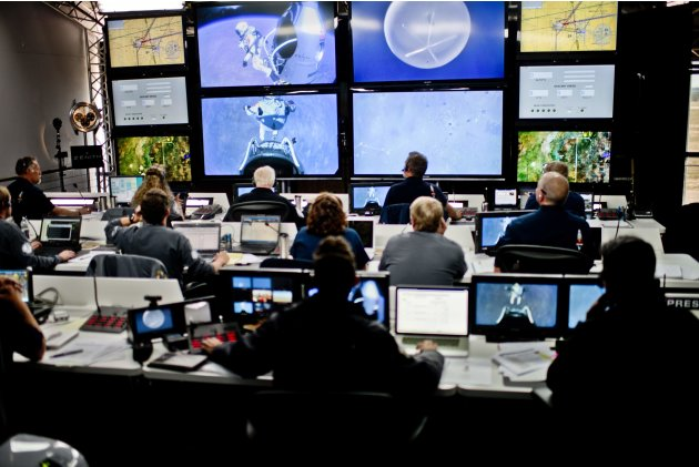 Handout photo of crew members at the mission control watching the jump of pilot Felix Baumgartner of Austria during the final manned flight for Red Bull Stratos in Roswell