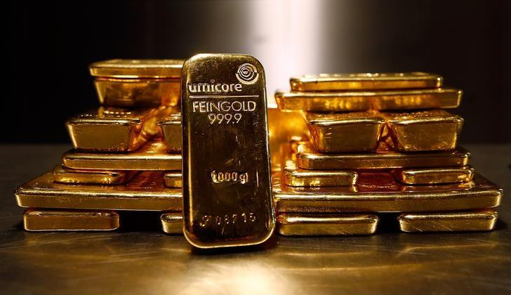 Gold bars are stacked in safe deposit boxes room of the ProAurum gold house in Munich