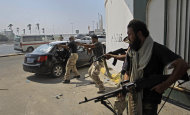 Libyan rebel fighters fire towards forces loyal to Moammar Gadhafi during fierce gunfire in downtown Tripoli, Libya, Monday, Aug. 22, 2011. World leaders said Monday the end is near for Moammar Gadhafi's regime and began planning for Libya's future without the man who has held power there for 42 years. (AP Photo/Sergey Ponomarev)
