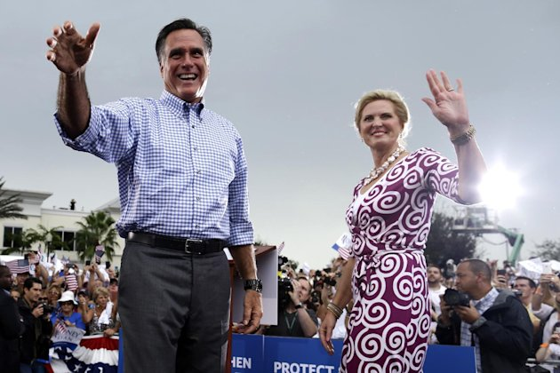 Republican presidential candidate and former Massachusetts Gov. Mitt Romney and wife Ann campaign at Tradition Town Square in Port St. Lucie, Fla., Sunday, Oct. 7, 2012. (AP Photo/Charles Dharapak)
