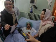 Afghanistan's acting Minister of Public Health Suraya Dalil (L) and Afghanistan's caretaker Minister for Women's Affairs Dr Husn Banu Ghazanfar visit an Afghan girl, who was tortured for months after refusing prostitution, as she lies on a hospital bed in Kabul December 31, 2011.  REUTERS/Omar Sobhani