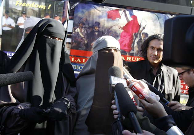 Kenza Drider, 32, center, addresses reporters after announcing that she will be candidate for the 2012 French presidential elections, in Meaux, east of Paris, Thursday Sept. 22, 2011. Kenza Drider sai