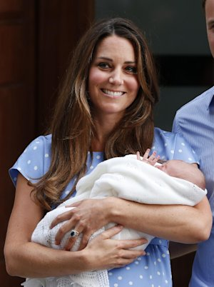 Kate, Duchess of Cambridge holds the Prince of Cambridge,…