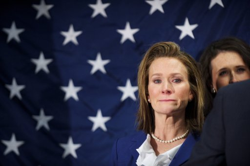 Karen Santorum tears up as husband Rick announces he is suspending his bid to win the Republican nomination during a news conference in Gettysburg, Pennsylvania