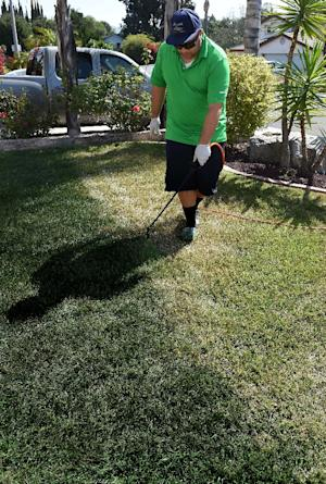 Cy Bodden from the San Diego company LawnLift sprays…