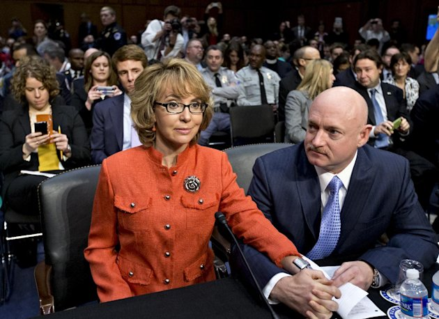 FILE - In this Jan. 30, 2013 file photo, former former U.S. Rep. Gabrielle Giffords, who survived a gunshot to the head in 2011, during a mass shooting in Tucson, Ariz., sits ready with her husband, retired astronaut Mark Kelly, at a Senate Judiciary Committee hearing on Capitol Hill in Washington to discuss legislation to curb gun violence after the death of 20 schoolchildren in the shooting rampage late last year in Newtown, Conn. Giffords told the committee that Congress must reform the nation's gun laws, and Kelly got into a terse discussion at the witness table with National Rifle Association Executive Vice President Wayne LaPierre. (AP Photo/J. Scott Applewhite, File)