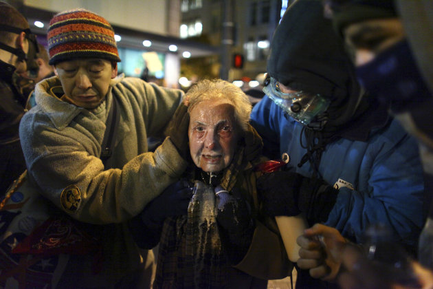 Seattle activist Dorli Rainey, 84, reacts after being hit with pepper spray during an Occupy Seattle protest on Tuesday, Nov. 15, 2011 at Westlake Park in Seattle. Protesters gathered in the intersect