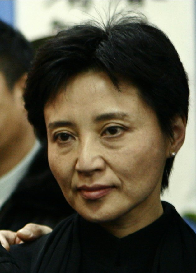File photo of Gu, wife of China's former Chongqing Municipality Communist Party Secretary Bo Xilai, posing for a group photo in Beijing