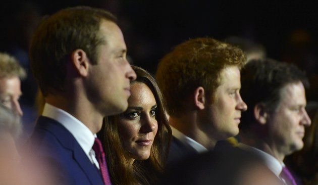 Britain's Prince William,  his wife Catherine, Duchess of Cambridge and Prince Harry watch the opening ceremony of the London 2012 Olympic Games at the Olympic Stadium