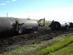 Derailed oil tanker cars lie off track near Culbertson, …