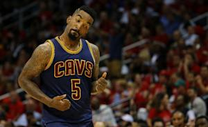 J.R. Smith of the Cleveland Cavaliers reacts after …
