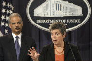 Attorney General Eric Holder listens at left as Homeland Security Secretary Janet Napolitano speaks at the Justice in Washington, Wednesday, Aug. 3, 2011, to discuss the results of the largest U.S. prosecution of an international criminal network organized to sexually exploit children. (AP Photo/Jacquelyn Martin)
