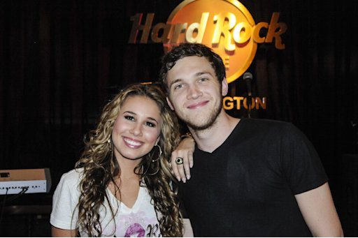 """IMAGE DISTRIBUTED FOR HARD ROCK - Haley Reinhart, left, who placed third in the tenth season of """"American Idol,"""" and """"American Idol"""" Season 11 winner Phillip Phillips, right,  kick off the Under 40 Music Marathon as part of Hard Rock's 12th Annual PINKTOBER breast cancer awareness campaign at Hard Rock Cafe, on Friday, Sept. 28, 2012, in Washington. (Invision for Hard Rock/AP Images)"""