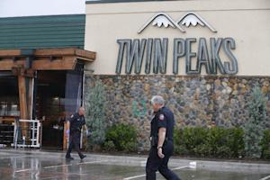 Waco police officers walk along the perimeter of Twin …