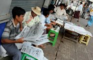 Yangon residents are seen here reading local newspapers. The head of Myanmar's repressive state censorship body has called for press freedom in the army-dominated country -- even suggesting his own department should be shut down, according to a report. (AFP Photo/)