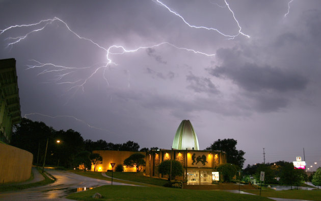Lightning illuminates the sky above the Pro Football Hall of Fame, Tuesday, June 21, 2011, in Canton, Ohio. (AP Photo/The Canton Repository, Scott Heckel) MANDATORY CREDIT