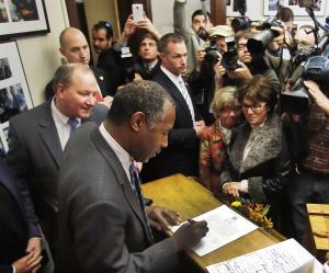 Republican presidential candidate, Dr. Ben Carson signs…