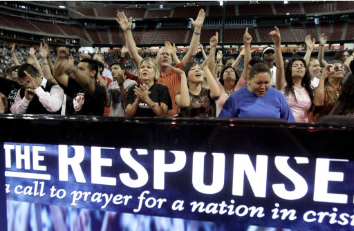 Participants sing and pray at The Response, a call to prayer for a nation in crisis, Saturday, Aug. 6, 2011, in Houston. Texas Gov. Rick Perry is scheduled to attend the daylong prayer rally despite criticism that the event inappropriately mixes religion and politics. (AP Photo/David J. Phillip)