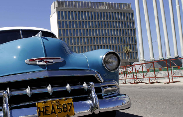 An American classic car is parked near the U.S Interests section building in Havana, Cuba, Friday Nov. 2, 2012. Cuba denounced the American diplomatic mission on the island on Friday for what it called subversive activities designed to undermine the government of Raul Castro. The Foreign Ministry said the Americans illegally give classes inside the walls of the U.S. Interests Section, which Washington maintains instead of an embassy, and provide Internet service without permission. (AP Photo/Franklin Reyes)