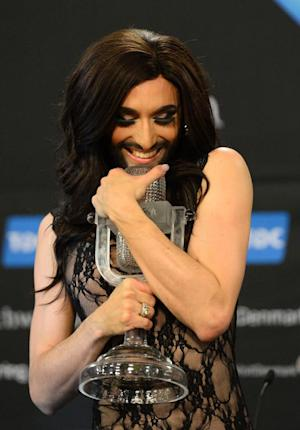 Austria's Conchita Wurst poses with the trophy …