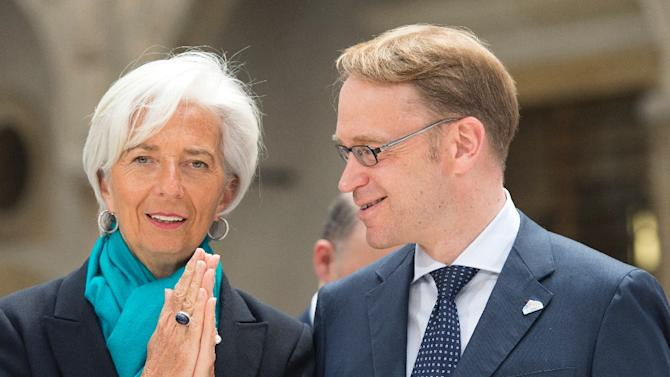 IMF Managing Director Christine Lagarde (L) and the President of the German Federal Bank Jens Weidmann talk during the G7 summit of Finance ministers at the Palace Residenzschloss in Dresden, Germany, May 28, 2015